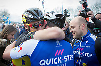race winner Yves Lampaert (BEL/Quick Step Floors) hugged by teammate Philippe Gilbert (BEL/Quick Step floors) after the finish line who came in 2nd after a well played out team strategy <br /> <br /> 72nd Dwars door Vlaanderen 2017