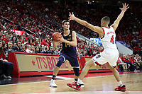 RALEIGH, NC - JANUARY 9: Nate Laszewski #14 of the University of Notre Dame is defended by Jericole Hellems #4 of North Carolina State University during a game between Notre Dame and NC State at PNC Arena on January 9, 2020 in Raleigh, North Carolina.