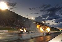 Jul, 22, 2011; Morrison, CO, USA: NHRA top fuel dragster driver David Grubnic (near lane) loses traction alongside Brandon Bernstein during qualifying for the Mile High Nationals at Bandimere Speedway. Mandatory Credit: Mark J. Rebilas-