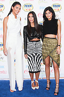 LOS ANGELES, CA, USA - AUGUST 10: Kendall Jenner, Kim Kardashian and Kylie Jenner arrive at the Teen Choice Awards 2014 held at The Shrine Auditorium on August 10, 2014 in Los Angeles, California, United States. (Photo by Celebrity Monitor)
