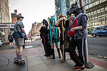 © Joel Goodman - 07973 332324 . 25/07/2015 . Manchester , UK . At a bus stop on Deansgate . Visitors to Comic Con on the streets of Manchester after venue - Manchester Central's - doors are shut . Photo credit : Joel Goodman