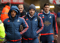 (L-R) Wayne Routledge, Alberto Paloschi and Federico Fernandez of Swansea arrive before the Barclays Premier League match between Swansea City and Crystal Palace at the Liberty Stadium, Swansea on February 06 2016