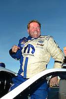 Oct. 28, 2012; Las Vegas, NV, USA: NHRA pro stock driver Allen Johnson celebrates after winning the Big O Tires Nationals at The Strip in Las Vegas. Mandatory Credit: Mark J. Rebilas-