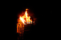 A fire burns in the Taj Mahal Palace Hotel after multiple terrorist attacks were launched in Mumbai on 26/11/2008..
