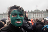 The green face of this protester in front of the Winter Palace expresses soldiarity with Russia oppositional Alexsei Navalny as he was attacked with green pinter colour last week . He takes part in the anti-corruption protest organised by Navalny in Saint Petersburg and the rest of Russia on the 26.03.2017. With thouasands particpating these are the biggest demonstrations in Russia since 2011.