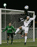 Stefan St. Louis #6 of Oakland leans over Joseph Lapira #10 of Notre Dame to win a header. The University of Notre Dame defeated Oakland University 2-1 in the second round of the NCAA championship at Alumni Field at the University of Notre Dame in South Bend, Indiana on November 28, 2007.