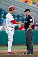 "Manager Ron Warner (57) of the Springfield Cardinals argues with third base umpire Ryan Blakney about a Tulsa player called ""safe"" during a game against the Tulsa Drillers at Hammons Field on July 18, 2011 in Springfield, Missouri. (David Welker / Four Seam Images)"