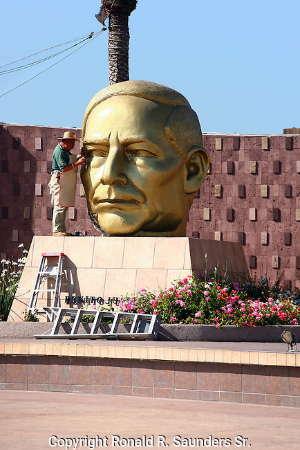 WORKER MAKES REPAIRS to HUGE GOLD PLATED STATUE of FAMOUS MEXICAN LEADER, BENITO JUAREZ