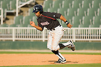Kyle Colligan #23 of the Kannapolis Intimidators takes off for second base against the West Virginia Power at Fieldcrest Cannon Stadium April 25, 2010, in Kannapolis, North Carolina.  Photo by Brian Westerholt / Four Seam Images