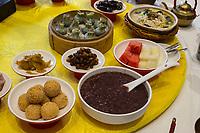 Yangzhou, Jiangsu, China.  Breakfast at Ye Chun Tea House.  Sesame Seed Balls of Glutinous Rice lower left; Jade buns upper middle.