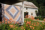 Quilt Hangs Outside an Old Farm House