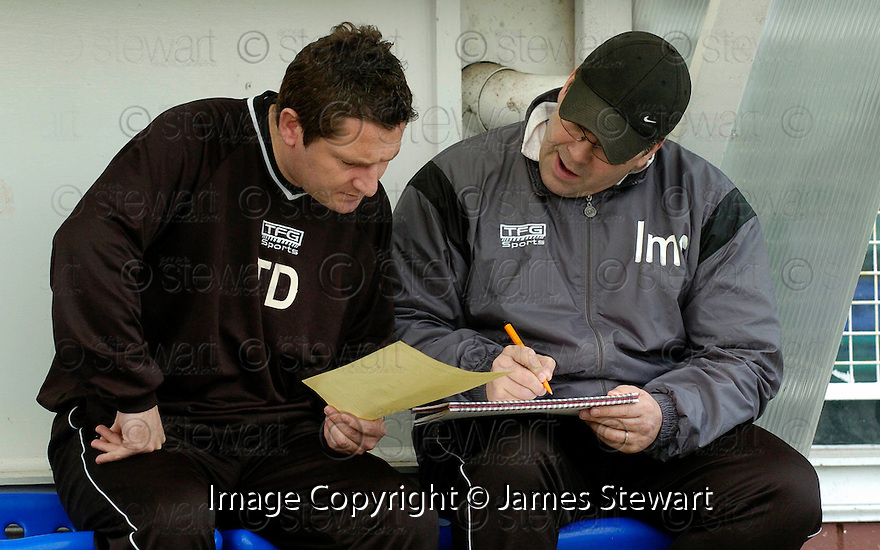 05/02/2005  Copyright Pic : James Stewart.File Name : jspa03_qots_v_dundee_utd.DUNDEE UTD MANAGER IAN MCCALL WORKS OUT HIS TEAM'S TACTICS WITH TONY DOCHERTY IN THE DUG OUT AN HOUR BEFORE THE START OF THE SCOTTISH CUP 4TH ROUND CLASH AGAINST QUEEN OF THE SOUTH...Payments to :.James Stewart Photo Agency 19 Carronlea Drive, Falkirk. FK2 8DN      Vat Reg No. 607 6932 25.Office     : +44 (0)1324 570906     .Mobile   : +44 (0)7721 416997.Fax         : +44 (0)1324 570906.E-mail  :  jim@jspa.co.uk.If you require further information then contact Jim Stewart on any of the numbers above.........A