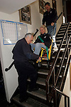ROXBURY, CT05 January 2006-010506TK13 (left to right:)Roxbury Ambulance Volunteers Donald Greenstein, Mary Elizabeth Peck and Roxbury Ambulance Chief Bernie Meehan demonstrate a new device that will provide a safer and easier method of transporting patients down stairs. Tom Kabelka / Republican-American (Donald Greenstein, Mary Elizabeth Peck, Bernie Meehan)CQ