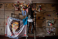 Silvia Coimbra visits the grave where the singer and her daughter, young Mariel, are buried.