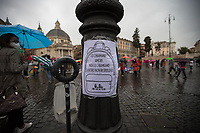 "Rome, 26/09/2020. Today, thousands of professors, teachers, students, parents, state school workers, Trade Unions, led by ""Priorità Alla Scuola"", held a national demonstration in Piazza del Popolo to protest against the Minister of Education Lucia Azzolina's policies to restart the State School after the pandemic Covid-19/Coronavirus. Protesters, battered by heavy rain, claimed that the country cannot afford to restart after the pandemic with a school lower training offer, due to delays and insufficient resources, and there is actually a need of strong investment in strategic sectors, starting with education and university research. From the organiser Facebook event page: «[…] many associations, trade unions, organizations related to the world of education, together with parents, teachers, students, male and female school workers will take to the streets with a common goal: to reaffirm the central role and priority of the school in our society, regardless of the individual and professional interests of each category, because if the school is not at the center of the political agenda, there can be no growth for the country, neither human, nor civic, nor economic. The right to education must be guaranteed to all in equal measure: from kindergarten to university. Without school there are no rights. […]».<br />