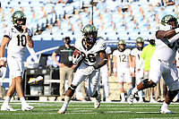 CHAPEL HILL, NC - NOVEMBER 14: Christian Beal-Smith #26 of Wake Forest runs the ball during a game between Wake Forest and North Carolina at Kenan Memorial Stadium on November 14, 2020 in Chapel Hill, North Carolina.