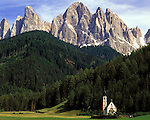 Italy, South Tyrol, Alto Adige, Dolomites, Val di Funes: church San Giovanni and Le Odle mountains at natural park Puez-Odle