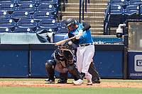 Tampa Tarpons catcher Carlos Narvaez (5) bats during a game against the Lakeland Flying Tigers on July 18, 2021 at George M. Steinbrenner Field in Tampa, Florida.  Also shown catcher Gresuan Silverio (51).  (Mike Janes/Four Seam Images)