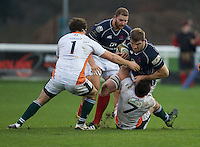 Will Carrick-Smith of London Scottish Football Club is tackled by Alex Bradley of Ealing Trailfinders during the Greene King IPA Championship match between London Scottish Football Club and Ealing Trailfinders at Richmond Athletic Ground, Richmond, United Kingdom on 26 December 2015. Photo by Alan  Stanford / PRiME Media Images