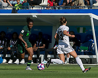 GRENOBLE, FRANCE - JUNE 22: Desire Oparanozie #9 of the Nigerian National Team dribbles at midfield during a game between Panama and Guyana at Stade des Alpes on June 22, 2019 in Grenoble, France.