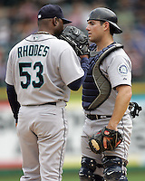 Seattle Mariners C Jeff Clement visits with P Arthur Rhodes against the Texas Rangers on May 14th, 2008 at Texas Rangers Ball Park. Photo by Andrew Woolley / Four Seam Images.
