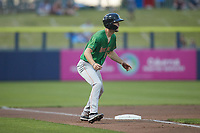 Evan Carter (11) of the Down East Wood Ducks takes his lead off of third base against the Kannapolis Cannon Ballers at Atrium Health Ballpark on May 5, 2021 in Kannapolis, North Carolina. (Brian Westerholt/Four Seam Images)