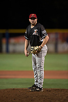 Salem-Keizer Volcanoes relief pitcher Matt Frisbee (45) looks in for the sign during a Northwest League game against the Hillsboro Hops at Ron Tonkin Field on September 1, 2018 in Hillsboro, Oregon. The Salem-Keizer Volcanoes defeated the Hillsboro Hops by a score of 3-1. (Zachary Lucy/Four Seam Images)
