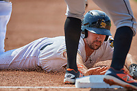 Zach Houchins (5) of the Salt Lake Bees slides into third base during the game against the Fresno Grizzlies at Smith's Ballpark on September 4, 2017 in Salt Lake City, Utah. Fresno defeated Salt Lake 9-7. (Stephen Smith/Four Seam Images)