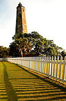 "Bald Head Lighthouse, fondly known as Old Baldy, is the oldest lighthouse in North Carolina. The distressed-stone and mottled stucco plaster lighthouse with an octagonal tower is located on Bald Head Island, an island and village located on the east side of the Cape Fear River in Brunswick County, NC. The current Old Baldy was completed in 1817 to replace an older lighthouse that was wearing out. Old Baldy light house is 110 feet high, with 108 steps to its top. The light house was used mostly to guide ships through the perilous Frying Pan Shoals, then was decommissioned after the Oak Island Lighthouse was constructed in 1958.  ""Old Baldy"" continues to stand as a symbol of Bald Head Island. Bald Head Island is accessible only by ferry from the nearby town of Southport, NC. One visitors and residents arrive on Bald Head Island, they drive modified electric golf carts, since cars are not allowed on the island. Charlotte NC photographer Patrick Schneider has extensive photo collections of the following lighthouses: Bodie Island Lighthouse, Bald Head Island Lighthouse, Cape Fear Lighthouse, Cape Hatteras Lighthouse, Cape Lookout Lighthouse, Currituck Beach Lighthouse, Diamond Shoal Lighthouse, Federal Point Lighthouse, Oak Island Lighthouse, and Ocracoke Lighthouse on Ocracoke Island."