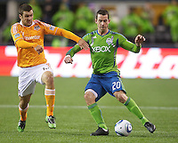 Seattle Sounders FC defender Zach Scott tries to keep the ball away from Houston Dynamo forward Will Bruin during play at Qwest Field in Seattle Friday March 25, 2011. The match ended in a 1-1 draw.