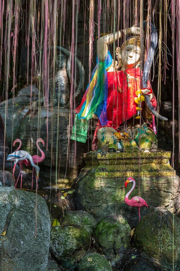Bangkok, Thailand. Goddess of the Earth, Phra Mae Thorani, Wringing Water out of her Hair, at Entrance to Wat Saket (Phu Khao Thong), the Golden Mount.