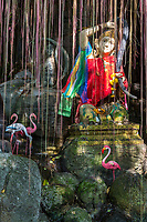Bangkok, Thailand. Goddess of the Earth, Phra Mae Thorani, Wringing Water out of her Hair, at Entrance to Wat Saket (Phu Khao Thong), the Golden Mount.