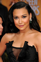 13 July 2020 - Naya Rivera, the actress best known for playing cheerleader Santana Lopez on Glee, has been confirmed dead. Rivera, 33, is believed to have drowned while swimming in the lake with her 4-year-old son, who was found asleep on their rental pontoon boat after it was overdue for return. 27 January 2013 - Los Angeles, California - Naya Rivera. 19th Annual Screen Actors Guild Awards - Arrivals held at The Shrine Auditorium. Photo Credit: Byron Purvis/AdMedia