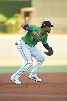 Gwinnett Stripers third baseman Pedro Florimon (18) prepares to make a throw to second base against the Scranton/Wilkes-Barre RailRiders at Coolray Field on August 16, 2019 in Lawrenceville, Georgia. The Stripers defeated the RailRiders 5-2. (Brian Westerholt/Four Seam Images)