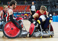 18 APR 2012 - LONDON, GBR - Great Britain's Steve Brown (GBR) (Class 2.0) (right) tries to score despite a challenge from Canadian Jason Crone (CAN) (Class 1.5) (left) during the London International Invitational Wheelchair Rugby Tournament match at the Olympic Park Basketball Arena in Stratford, London, Great Britain .(PHOTO (C) 2012 NIGEL FARROW)