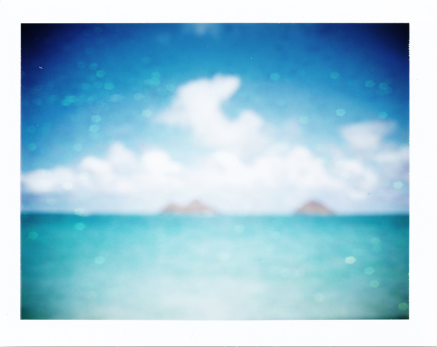 photograph of Na Mokulua (mokes) in Lanikai by liisa roberts.  Using Polaroid land camera and a bokeh overlay.  Bokeh overlay provided by regularjane on Deviant Art.