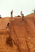 Ouro Verde, Brazil. Young garimpeiros (prospectors) with hand tools digging in an illegal gold mine - garimpo.