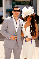 1st May 2021; Kentucky, USA;  A sharp dressed couple enjoying their time together while attending the 147th running of the Kentucky Derby on May 01st, 2021 at Churchill Downs in Louisville,  Kentucky, USA.