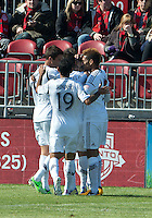 30 March 2013:The LA Galaxy players cele brat a goal by Los Angeles Galaxy midfielder Jose Villarreal #33 during an MLS game between the LA Galaxy and Toronto FC at BMO Field in Toronto, Ontario Canada..The game ended in a 2-2 draw..