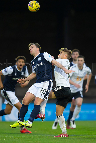 21st November 2020; Somerset Park, Ayr, South Ayrshire, Scotland; Scottish Championship Football, Ayr United versus Dundee FC; Paul McGowan of Dundee competes in the air with Andy Murdoch of Ayr United