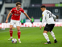 7th November 2020; Pride Park, Derby, East Midlands; English Football League Championship Football, Derby County versus Barnsley; Callum Brittain of Barnsley challenges Lee Buchanan of Derby County