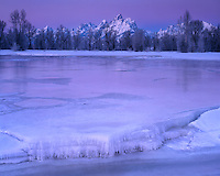 Twilight glow on an ice field on Spread Creek along the Snake River; Grand Teton National Park, WY