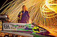 Racer, model & student Erin Pittman poses with her raceboat near her home in Indiana.