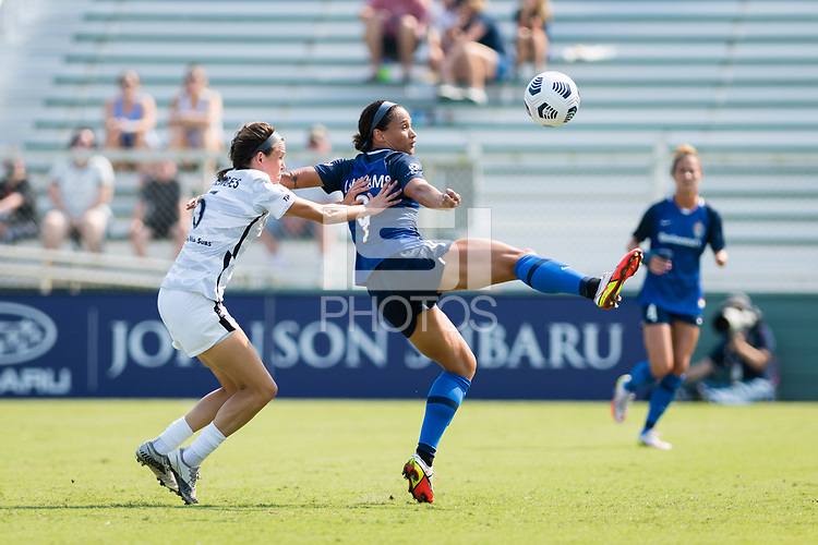 CARY, NC - SEPTEMBER 12: Emily Menges #5 of the Portland Thorns and Lynn Williams #9 of the NC Courage battle for the ball during a game between Portland Thorns FC and North Carolina Courage at WakeMed Soccer Park on September 12, 2021 in Cary, North Carolina.