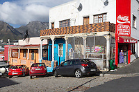 South Africa, Cape Town, Bo-kaap.  Corner Grocery Store.  Table Mountain in background.