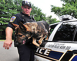 Enfield Police officer Michael Colantuono and his dog Ranger, as he comes out of the car, Tuesday, June 30, 2015, at the Enfield Police station. (Jim Michaud / Journal Inquirer)