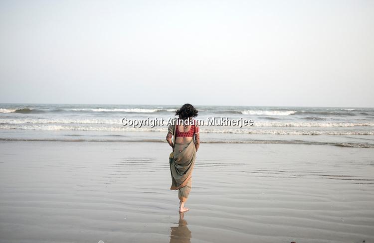 Dipmalya walks down the beach at Udaipur, Orissa, India. Arindam Mukherjee