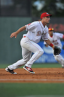 Third baseman Mitchell Gunsolus (22) of the Greenville Drive reacts to a ground ball in a game against the Augusta GreenJackets on Wednesday, May 4, 2016, at Fluor Field at the West End in Greenville, South Carolina. Greenville won, 6-3. (Tom Priddy/Four Seam Images)