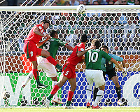 Vahid Hashemaian (9) of Iran leaps over the Mexican defense for a header. Mexico defeated Iran 3-1 during a World Cup Group D match at Franken-Stadion, Nuremberg, Germany on Sunday June 11, 2006.