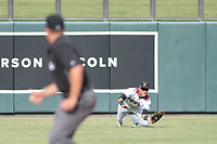Salt River Rafters left fielder Victor Reyes (5), of the Arizona Diamondbacks organization, makes a diving catch during an Arizona Fall League game against the Mesa Solar Sox on October 30, 2017 at Salt River Fields at Talking Stick in Scottsdale, Arizona. The Solar Sox defeated the Rafters 8-4. (Zachary Lucy/Four Seam Images)